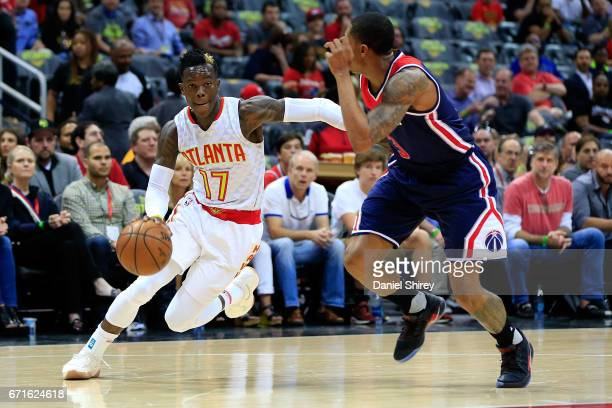 Dennis Schroder of the Atlanta Hawks drives to the basket past Bradley Beal of the Washington Wizards during the first quarter in Game Three of the...