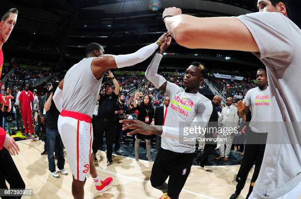 Dennis Schroder of the Atlanta Hawks gets introduced before the game against the Charlotte Hornets on April 11 2017 at Philips Arena in Atlanta...