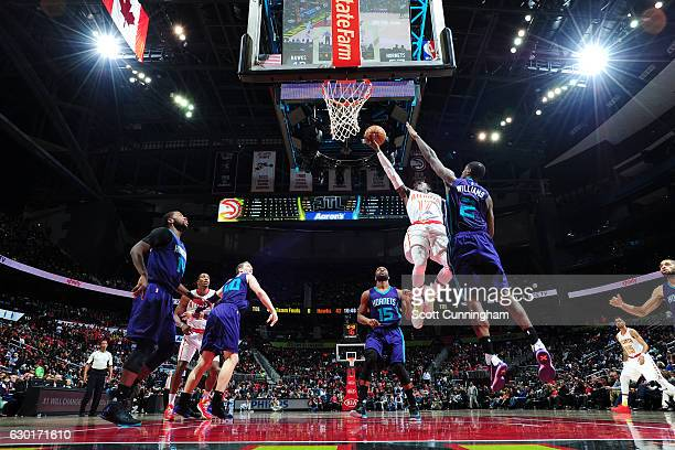 Dennis Schroder of the Atlanta Hawks goes for the lay up during the game against the Charlotte Hornets on December 17 2016 at Philips Arena in...