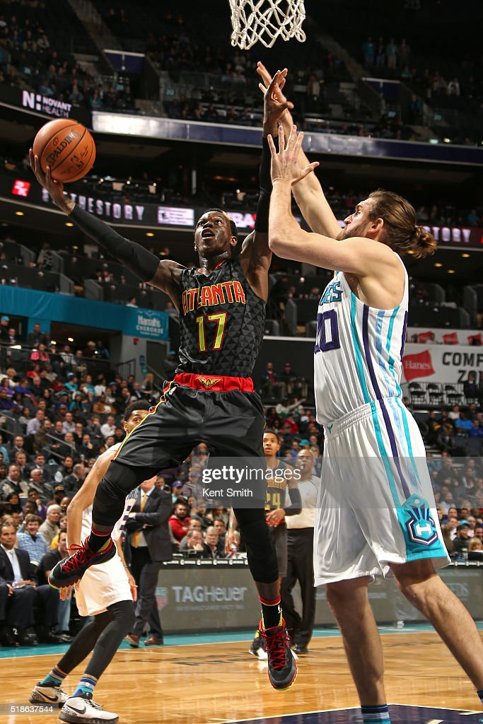 Dennis Schroder #17 of the Atlanta Hawks goes for the layup during the game against the Charlotte Hornets on January 13, 2016 at Time Warner Cable Arena in Charlotte, North Carolina.
