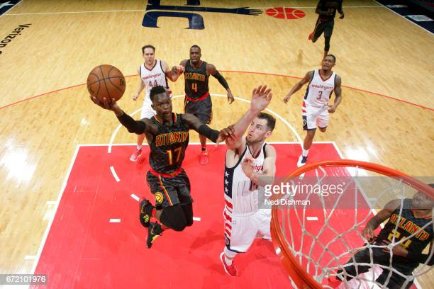 Dennis Schroder of the Atlanta Hawks goes to the basket against the Washington Wizards during Game Two of the Eastern Conference Quarterfinals of the...