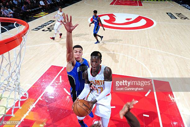 Dennis Schroder of the Atlanta Hawks goes to the basket during the game against the Orlando Magic on December 13 2016 at Philips Center in Atlanta...
