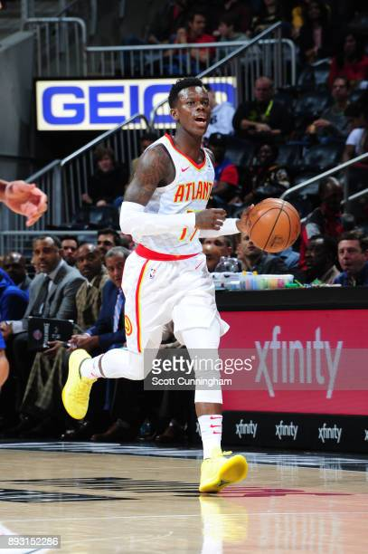 Dennis Schroder of the Atlanta Hawks handles the ball against the Detroit Pistons on December 14 2017 at Philips Arena in Atlanta Georgia NOTE TO...
