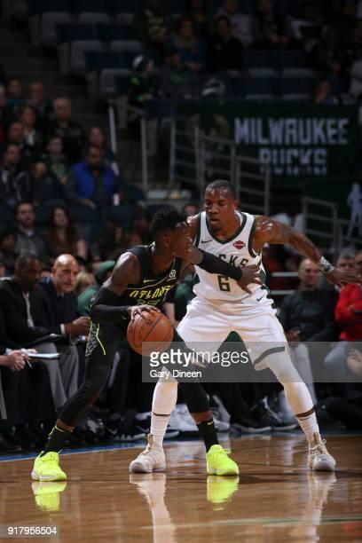 Dennis Schroder of the Atlanta Hawks handles the ball against the Milwaukee Bucks on February 13 2018 at the Bradley Center in Milwaukee Wisconsin...