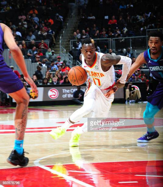 Dennis Schroder of the Atlanta Hawks handles the ball against the Charlotte Hornets on March 15 2018 at Philips Arena in Atlanta Georgia NOTE TO USER...