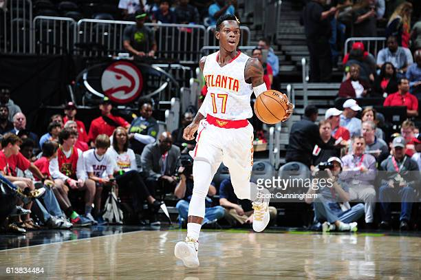 Dennis Schroder of the Atlanta Hawks handles the ball during a preseason game against the Cleveland Cavaliers on October 10 2016 at Philips Arena in...