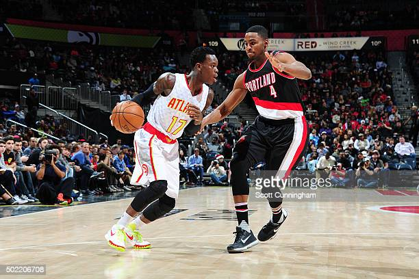 Dennis Schroder of the Atlanta Hawks handles the ball during the game against the Portland Trail Blazers on December 21 2015 at Philips Arena in...