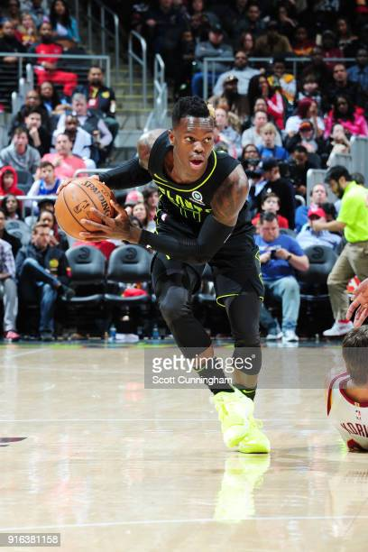 Dennis Schroder of the Atlanta Hawks handles the ball during the game against the Cleveland Cavaliers on February 9 2018 at Philips Arena in Atlanta...