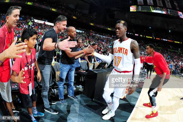 Dennis Schroder of the Atlanta Hawks high fives fans before the game against the Washington Wizards in Game Three of the Eastern Conference...