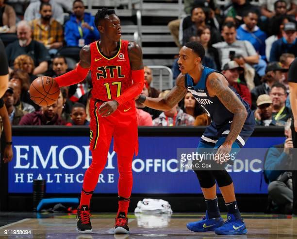Dennis Schroder of the Atlanta Hawks is defended by Jeff Teague of the Minnesota Timberwolves at Philips Arena on January 29 2018 in Atlanta Georgia...