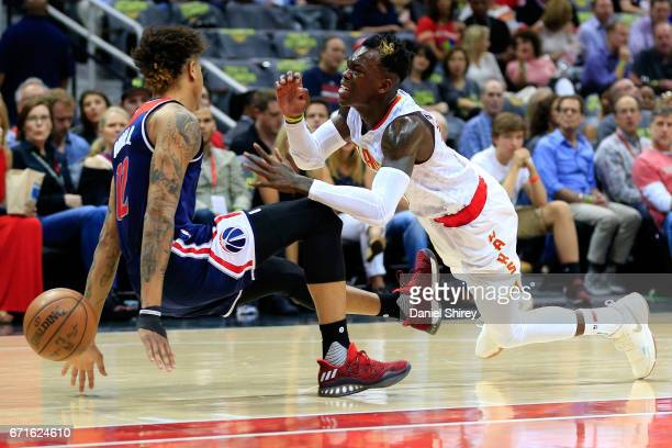 Dennis Schroder of the Atlanta Hawks is fouled by Kelly Oubre Jr. #12 of the Washington Wizards during the first quarter in Game Three of the Eastern...