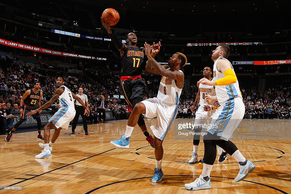 Dennis Schroder #17 of the Atlanta Hawks lays up a shot against Sean Kilpatrick #6 of the Denver Nuggets as Jusuf Nurkic #23, Darrell Arthur #00 and Will Barton #5 of the Denver Nuggets follow the play at Pepsi Center on January 25, 2016 in Denver, Colorado.