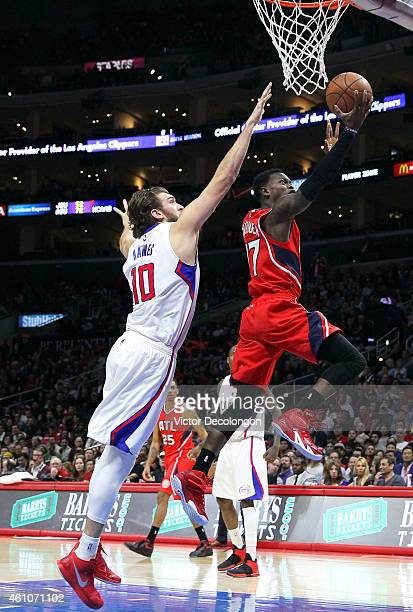 Dennis Schroder of the Atlanta Hawks lays up a shot past Spencer Hawes of the Los Angeles Clippers in the second half during the NBA game at Staples...