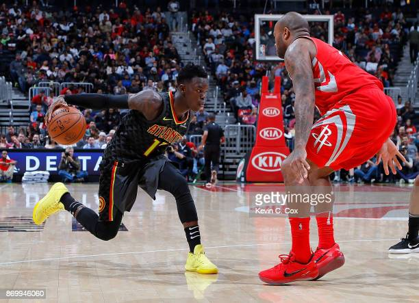 Dennis Schroder of the Atlanta Hawks looks to drives against PJ Tucker of the Houston Rockets at Philips Arena on November 3 2017 in Atlanta Georgia...