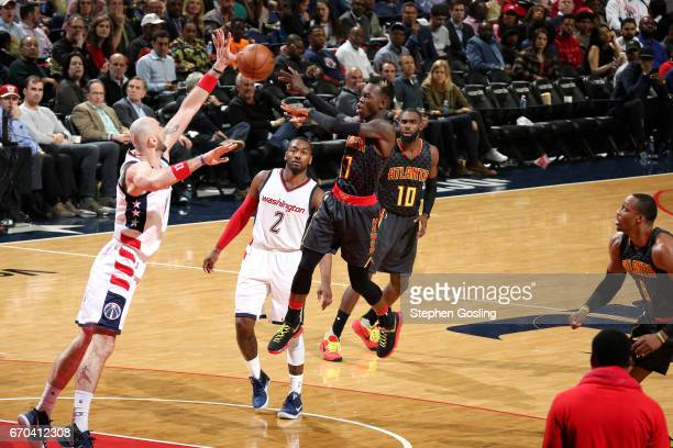 Dennis Schroder of the Atlanta Hawks passes the ball during the game against the Washington Wizards during Game Two of the Eastern Conference...