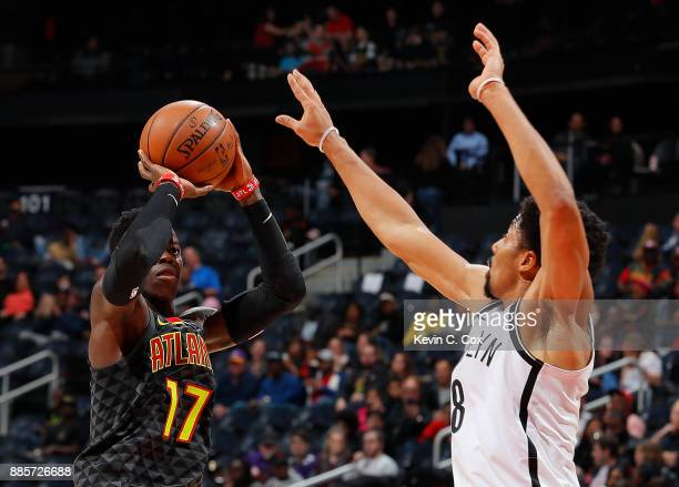 Dennis Schroder of the Atlanta Hawks shoots against Spencer Dinwiddie of the Brooklyn Nets at Philips Arena on December 4 2017 in Atlanta Georgia...