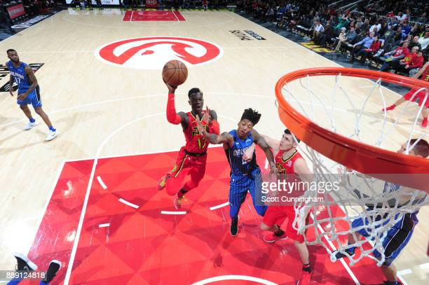 Dennis Schroder of the Atlanta Hawks shoots the ball against the Orlando Magic on December 9 2017 at Philips Arena in Atlanta Georgia NOTE TO USER...