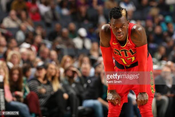 Dennis Schroder of the Atlanta Hawks stands on defense during the game against the Charlotte Hornets on January 26 2018 at Spectrum Center in...
