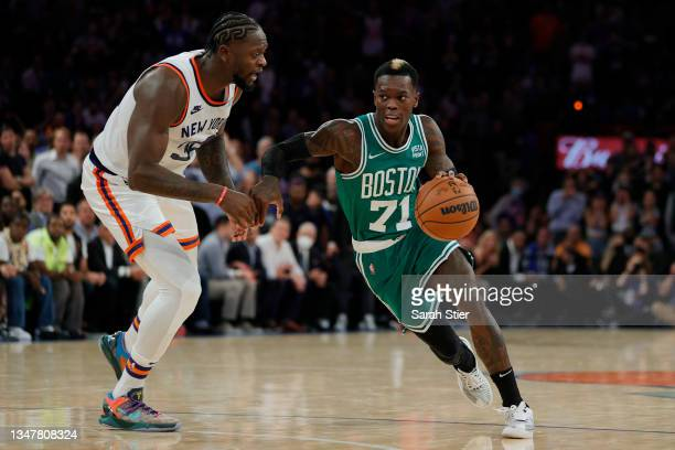 Dennis Schroder of the Boston Celtics dribbles as Julius Randle of the New York Knicks defends during first overtime at Madison Square Garden on...