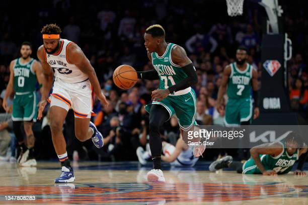 Dennis Schroder of the Boston Celtics dribbles as Mitchell Robinson of the New York Knicks defends during second overtime at Madison Square Garden on...