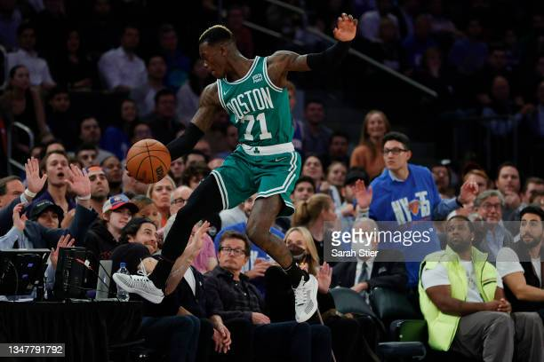 Dennis Schroder of the Boston Celtics leaps to keep the ball inbounds during the first half against the New York Knicks at Madison Square Garden on...