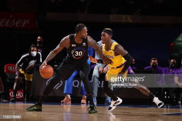 Dennis Schroder of the Los Angeles Lakers plays defense on Julius Randle of the New York Knicks during the game on April 12, 2021 at Madison Square...