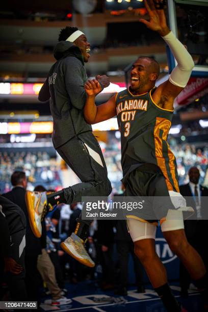 Dennis Schroder of the Oklahoma City Thunder and Chris Paul of the Oklahoma City Thunder get pumped up before the game against the New York Knicks on...