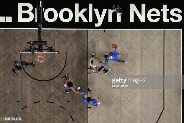 Dennis Schroder of the Oklahoma City Thunder carries the ball against Rodions Kurucs of the Brooklyn Nets at Barclays Center on January 07, 2020 in...