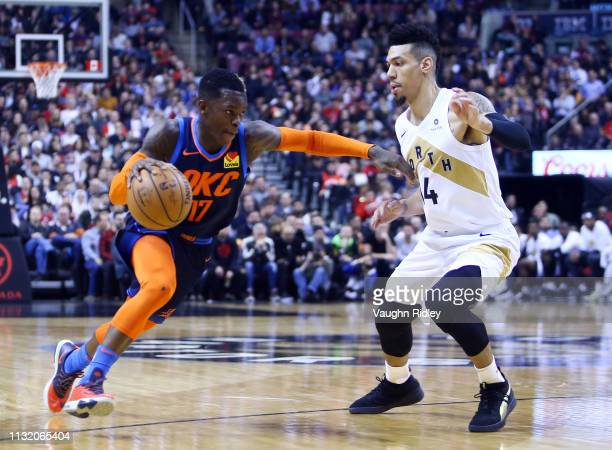 Dennis Schroder of the Oklahoma City Thunder dribbles the ball as Danny Green of the Toronto Raptors defends during the first half of an NBA game at...