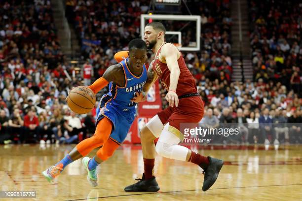 Dennis Schroder of the Oklahoma City Thunder drives to the basket defended by Austin Rivers of the Houston Rockets in the second half at Toyota...