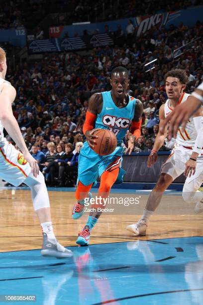 Dennis Schroder of the Oklahoma City Thunder handles the ball against the Atlanta Hawks on November 30 2018 at Chesapeake Energy Arena in Oklahoma...