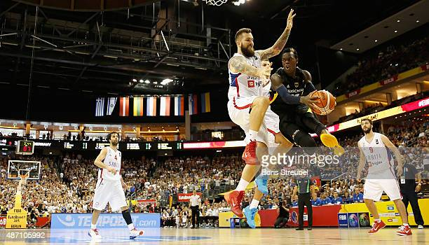 Dennis Schroeder of Germany drives to the basket against Miroslav Raduljica of Serbia during the FIBA EuroBasket 2015 Group B basketball match...