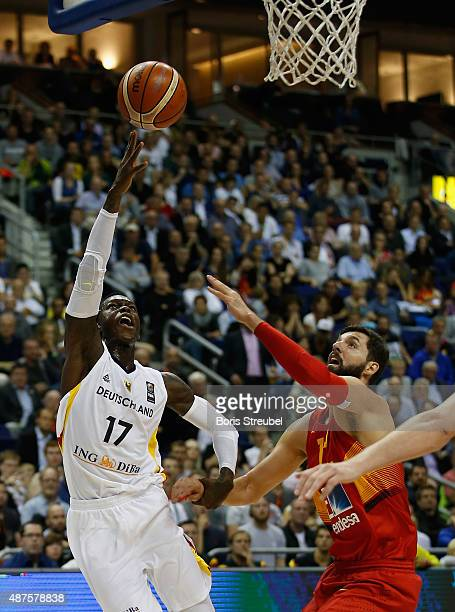 Dennis Schroeder of Germany drives to the basket against Nikola Mirotic of Spain during the FIBA EuroBasket 2015 Group B basketball match between...