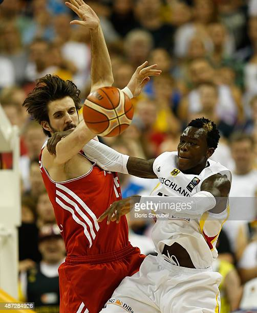 Dennis Schroeder of Germany fights for the ball with Furkan Aldemir of Turkey during the FIBA EuroBasket 2015 Group B basketball match between...