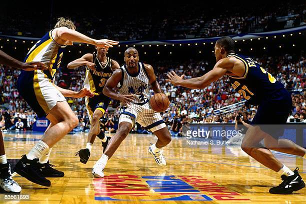 Dennis Scott of the Orlando Magic makes a move to the basket against Rick Smits of the Indiana Pacers in Game Seven of the 1995 NBA Eastern...