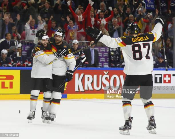 Dennis Seidenberg and Felix Schultz of Germany celebrate the second goal during the 2017 IIHF Ice Hockey World Championship game between USA and...
