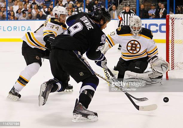 Dennis Seidenberg and Tim Thomas of the Boston Bruins defend against Steve Downie of the Tampa Bay Lightning in Game Six of the Eastern Conference...