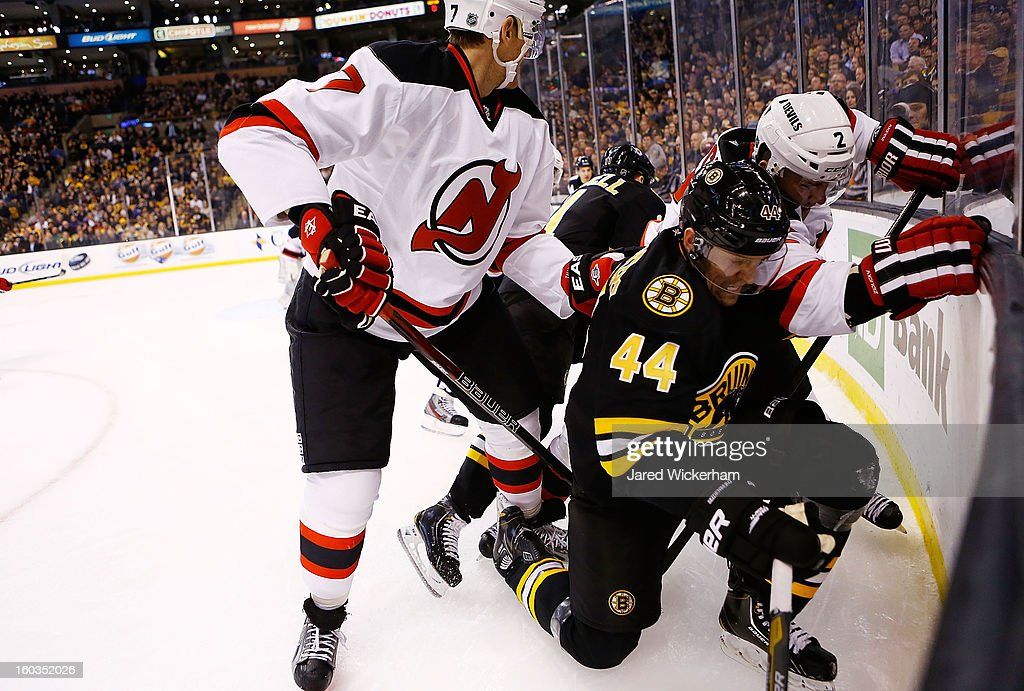 Dennis Seidenberg #44 of the Boston Bruins attempts to corral the puck in the corner against the New Jersey Devils during the game on January 29, 2013 at TD Garden in Boston, Massachusetts.