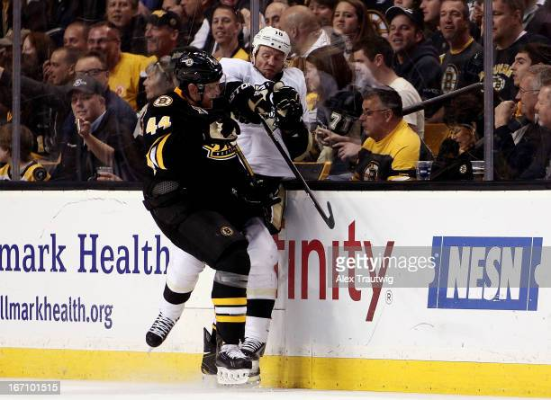 Dennis Seidenberg of the Boston Bruins checks Brenden Morrow of the Pittsburgh Penguins at the TD Garden on April 20 2013 in Boston Massachusetts
