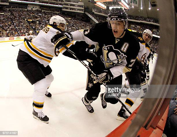 Dennis Seidenberg of the Boston Bruins checks Evgeni Malkin of the Pittsburgh Penguins in the second period at Mellon Arena on March 7 2010 in...