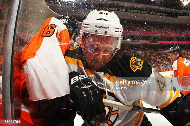 Dennis Seidenberg of the Boston Bruins checks Jaromir Jagr of the Philadelphia Flyers during their game on December 17 2011 at The Wells Fargo Center...