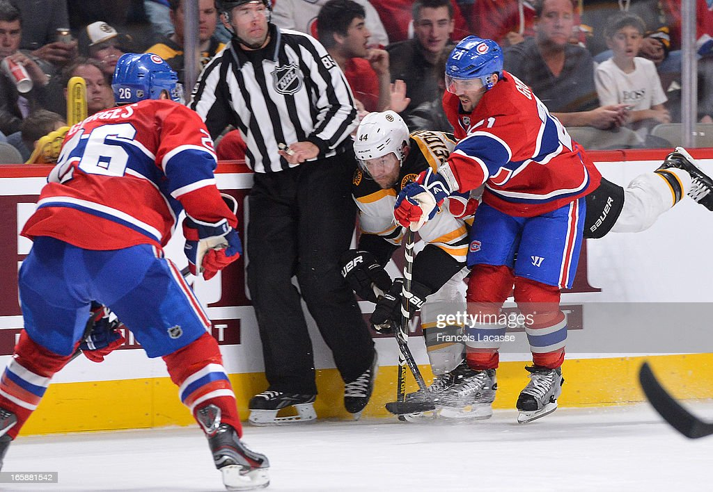Dennis Seidenberg #44 of the Boston Bruins collides with official battling for position with Brian Gionta #21of the Montreal Canadiens during the NHL game on April 6, 2013 at the Bell Centre in Montreal, Quebec, Canada.