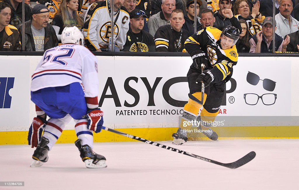brand new 4bce3 ba641 Dennis Seidenberg of the Boston Bruins shoots the puck ...