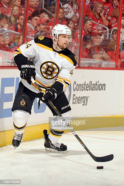 Dennis Seidenberg of the Boston Bruins skates with the puck during Game Three of the Eastern Conference Quarterfinals of the 2012 NHL Stanley Cup...
