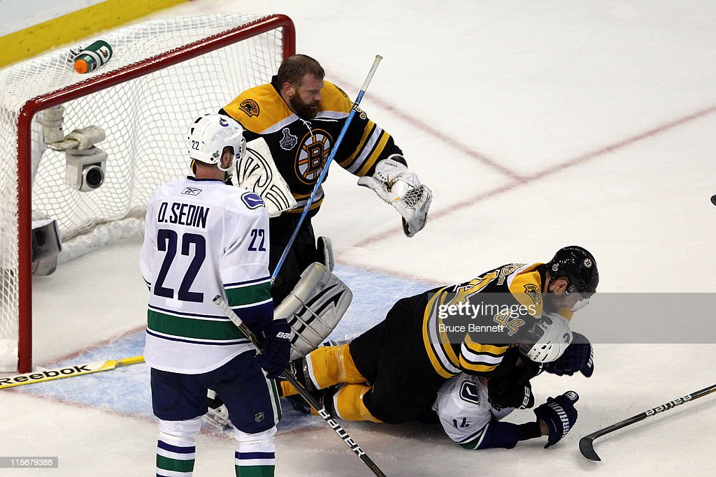 hot sale online afeba f24f3 Dennis Seidenberg of the Boston Bruins tackles Alex Burrows ...