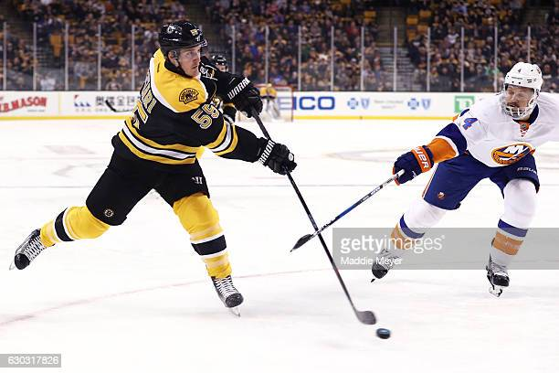Dennis Seidenberg of the New York Islanders defends a shot by Noel Acciari of the Boston Bruins during the first period at TD Garden on December 20...