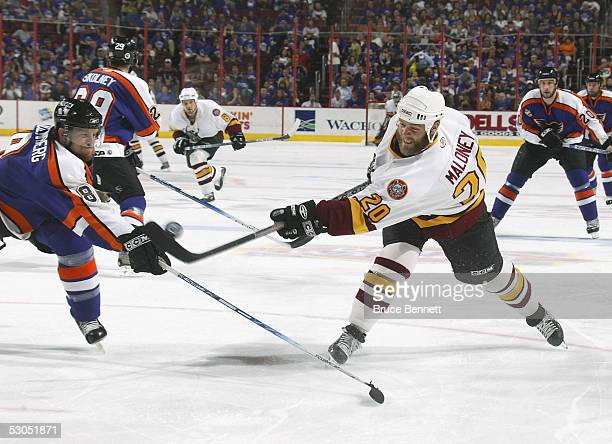 Dennis Seidenberg of the Philadelphia Phantoms moves in to poke check Brian Maloney of the Chicago Wolves during the American Hockey League Calder...