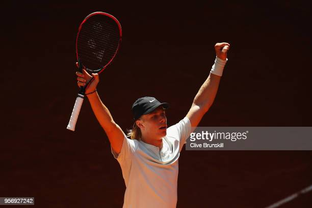 Dennis Shapovalov of Canada celebrates match point against Milos Raonic of Canada in their third round match during day six of the Mutua Madrid Open...