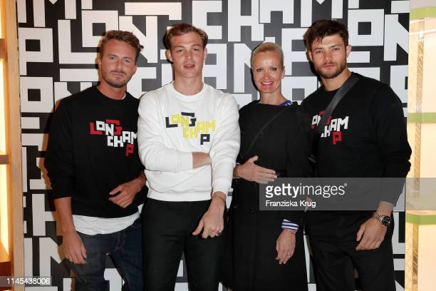 Dennis Sialkowski David Schuetter Sabine Nedelchev and Eugen Bauder attend the Longchamp store event on May 21 2019 in Munich Germany