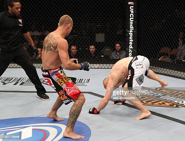 Dennis Siver is wobbled by a head kick from Donald Cerrone during the UFC 137 event at the Mandalay Bay Events Center on October 29, 2011 in Las...